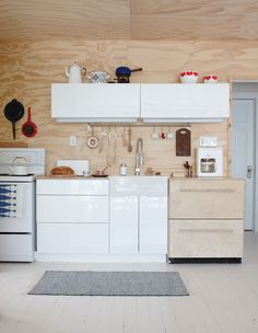 Plywood Cottage Kitchen Glossy white cabinets add a modern touch in a deconstructed space. Cottage Living Rooms, Cottage Kitchens, Cottage Homes, Small Kitchens, Plywood Interior, Plywood Walls, Wooden Walls, Modern Cottage, White Cottage