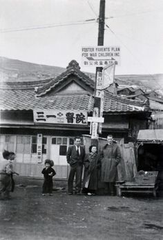 Robert Sage with two of his staff members in front of the Plan Korea Pusan office.