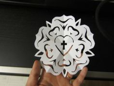 How to make a paper cut-out Luther Rose http://www.kellyklages.com/lutherrose.pdf #lutheran