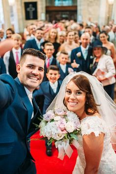 Image by Hannah May - Lace Justin Alexander Fishtail Gown for a family orientated classic wedding with Navy Suits, Pastel Bridesmaid dresses and a Mr & Mrs game during the speeches