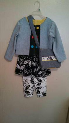 $35.00 USD Handmade. ONE OF A KIND!!! Made from recycled material with all the care this grandmother could offer. My 6 year old granddaughter, Dannielle, inspired this outfit. Fashion is her middle name. I started with the denim jacket. Then added the skirt. It was good. I added the leggings. It was better. Added the denim bag. Awesome! Denim jacket w/decorative buttons. Cotton skirt and leggings w/ elastic waists. Lined crossbody denim bag. Youth size 4-6.
