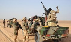 French troops talk with Malian soldiers outside Bourem, in northern Mali, on Sunday, Feb. (AP Photo/Pascal Guyot, Pool) Northern Mali a breeding ground for terrorists long before the current crisis Troops, Monster Trucks, The Outsiders, France, Information, Point, Sunday, Army Soldier, News Agency