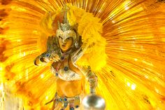 Carnival 2013 - The Big Picture - A reveler of Sao Clemente samba school performs during the second night of Carnival parade at the Sambadrome in Rio de Janeiro, Brazil, on Feb. 11. (Antonio Scorza/AFP/Getty Images)