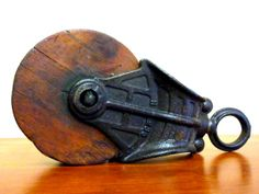 Industrial Wood & Cast Iron Pulley on Etsy, $54.00