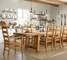 Benchwright Extending Table & Wynn Chair 11-Piece Dining Set | Pottery Barn. In Mahagony Stain.