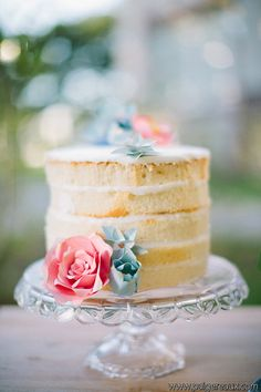 Unique Cake Toppers - paper flowers. I happen to like the look of this unfrosted cake.