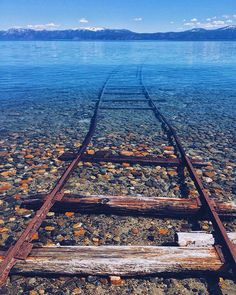 Tracks dissapear below the surface of Lake Tahoe, California | Photo by @heathmedders