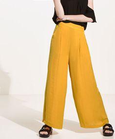 Pantalón satinado ancho amarillo   22,99 €   REF. 1733/035