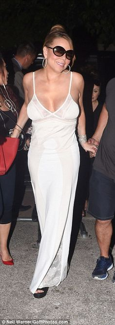 Mariah Carey shows off her ample assets in bodycon dress