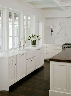 pretty white kitchen with dark floors