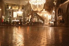 Wieliczka Salt Mine, located in the town of Wieliczka in southern Poland. The miners carved statues, a cathedral, and an underground lake out of the salt mine. Even the chandeliers are made of salt. Oh The Places You'll Go, Places Ive Been, Places To Visit, Prague, Wieliczka Salt Mine, Statues, Visit Poland, Underground Cities, Krakow Poland