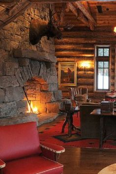 Rustic coziness. This stone fireplace says it all. #mountaincabin #rustic #fireplace #cozy