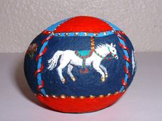 Four Horse Carrousel with Red and Blue Canopy Painted Rock via Etsy