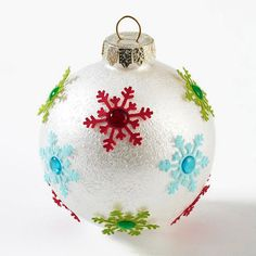 Metallic Snowflake Christmas Tree Ornaments ~ Dab metallic paint onto Christmas tree ornaments using a sponge to create texture. Punch snowflakes from cardstock and adhere just the centers (so the points are not secure). Top the snowflakes with round, epoxy stickers adhered to the centers for a frosty fun addition to your tree
