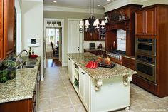 Large kitchen with extra counter space in The Hollingbourne, plan 990! http://www.dongardner.com/plan_details.aspx?pid=2670. #Kitchen #Island #Rustic