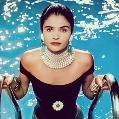 #HelenaChristensen takes a decked out dip. #Chanel #90s #PoolsAndJewels #PearlsOnGirls #TheStoneSet