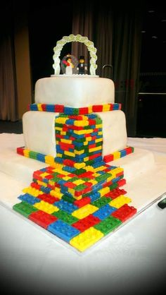 Made as a wedding cake for friends Lego is coloured white choc all individually molded Fondant icing over choc ganache Flourless choc cake base Then lemon pound cake Then fruit cake topper