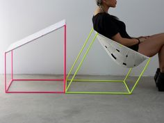 Neon conform chair. A woven elastic fabric is stretched over the frame resembling a meshed canvas.