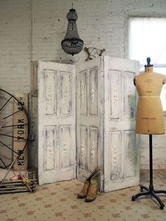 DIY Door Room Divider: Use recycled doors from a salvage yard and piano hinges (hinges that bend both ways) to connect the doors.