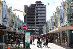 The changing face of Christchurch. Here the widely known BNZ building, overlooking the newly reopened New Regent Street, is slowly deconstructed. Earthquake damage made the building very unstable.