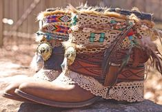 ankle boots in bohemian fashion, decorated with crochet lace ribbons, brown leather straps, gold chain and beads, feather and macrame details
