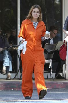 Jail chic:Tallulah Willis made a rather unusual fashion statement as she popped out for a coffee in a prison jumpsuit in the well-to-do Los Angeles suburb of Bel Air on Wednesday