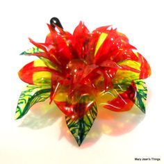 Hey, I found this really awesome Etsy listing at http://www.etsy.com/listing/118938649/upcycled-yellow-and-red-fantasy-flower