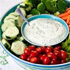Homemade vegetable dip with plenty of fresh, green herbs.