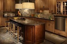 I like this kitchen design....it looks balanced and flows.  I do not like the lights or lighting.  I love the floor and backsplash.  I like it that it seems similiar to our kitchen small but practical.