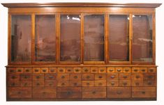 We purchased an antique apothecary cabinet (similar to this one) which used to belong to the parfumerie at Samaritaine. It is perfect for displaying all our books and bits whilst retaining an uncluttered feel.