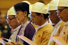 Big moment - Aung San Suu Kyi sworn in as a member of Burmese parliament. Photo: AFP/Soe Than Win