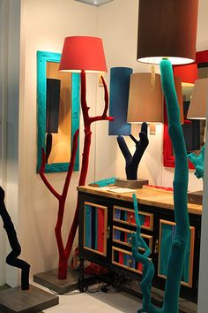 Made by Nic Parnell , these fantastic colourful lamps are part of the Flock Furniture range. Parnell is a London-based designer working with reclaimed wood sourced from tree surgeons that might otherwise be shredded. Parnell uses an electro-static flocking process to cover the wood in bright new textures