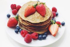 Recipe - 2 small servings: 4 eggs 2 bananas 1 cup oats 2-3 tablespoons skyr/greek yoghurt 1/4 teaspoon baking powder 1/2 teaspoon organic vanilla powder  Coconut oil to cook the pancakes in    Directions:  	Add all the ingredients to a blender or food processor and pulse until smoo....