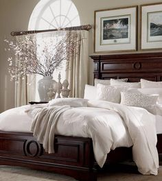 Bedroom decor--I love this look. Dark wood. White bedding. Gorgeous pillows. Sophisticated accessories. Heaven...