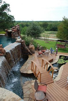 Pool, waterfall, stream, chair....I'm ready to move into the backyard!  The house may be a chicken coop, but who cares if THIS the view and play yard?!