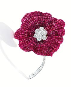 18 KARAT GOLD, PLATINUM, INVISIBLY-SET RUBY AND DIAMOND FLOWER BROOCH, OSCAR HEYMAN & BROTHERS
