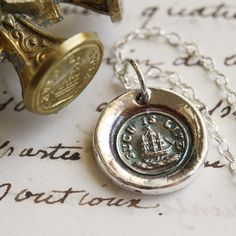 Such is Life Ship at Sea Victorian Wax Seal Necklace by Englady. $36.00, via Etsy.