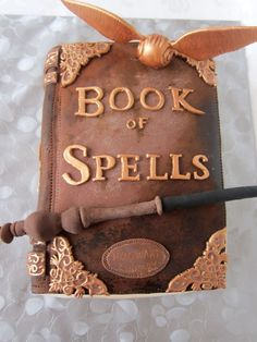 Harry Potter Book of Spells Cake. How awesome is this? Perfect for a Harry Potter Party! #cakedesigns