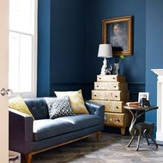 Get a cosy clubhouse feel with striking furniture, industrial accents and a chic, modern take on classic Chesterfield sofas