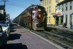 PRR Class EFP 35 (No. 9832) makes a stop in Sunbury, PA March 24, 1956 Chattanooga Choo Choo, New York Central Railroad, Railroad Pictures, Railroad History, Pennsylvania Railroad, Train Art, Covered Wagon, Train Engines, Diesel Locomotive