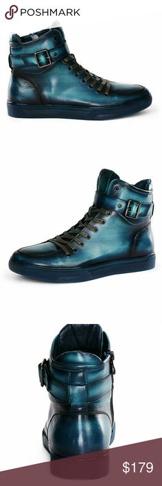JUMP NEW YORK SULLIVAN TURQUOISE HIGH TOP SNEAKER Material: Leather Upper  Sole: Rubber  Hand Painted Leather Padded Collar & Tongue Strap & Buckle Detail Padded Sock Lining Non-Skid Outsole Shaft Height (est.) : 5? Circumference (est.) : 12? Hook & Loop Closure Adjustable-Strap True To Size Jump Shoes Sneakers