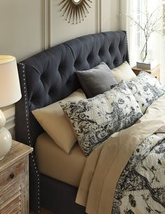 Beautiful bedroom features a gray wingback bed with silver for Christine huve interior designs