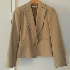 Banana Republic One-Button Blazer Vintage, one-button tan and cream wool blazer. It has two front pockets, thin built in shoulder pads and 4 buttons on the back of each sleeve. It is 90% wool and 10% nylon. The lining is a beautiful satin bronze made of 100% acetate. It can be dressed up for work, a party or a casual outing. Gently used, like new. Banana Republic Jackets & Coats Blazers