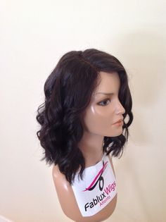 "*NEW* K-LOB $220.00 12-14"" LOB (Long Bob) Natural Wave (with a closure)  This Wig features a blunt cut long bob with side swept bangs  Color Shown: Natural Color  Collection: Full Wig with closure Hair Type: Virgin Indian Remy hair  Style: Natural Wave  Length: Mid length"