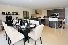 A contemporary kitchen with an open plan dining space. Kings Home, Property Development, Open Plan, Contemporary, How To Plan, Dining, Space, Kitchen, Floor Space