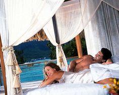 couple-canopy-bed.jpg [Honeymoon Couple on Canopy Bed in Bora Bora, Tahiti]