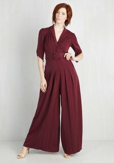 The Embolden Age Jumpsuit in Burgundy. In this golden era of inspiration, you feel encouraged to sport this light burgundy jumpsuit. #red #modcloth