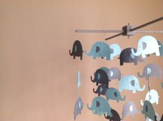 A personal favorite from my Etsy shop https://www.etsy.com/listing/188431087/elephant-crib-mobile-elephant-nursery