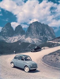 Publicity photo for the 1957 Fiat 500, manufactured from 1957 to 1975 in 2 door sedan and 3 door estate car variants.  The engine size (2 cylinder) was 479 cc, hence the 500 name, and its shape and popularity made it probably Italy's most iconic small car, although a being so small (only 3 metres long) it is a little hard to compare it exactly to the Morris Minor and the Citroen 2CV (text from 'transpressnz' - thanks!)