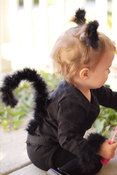 DIY: Black Cat Costume.  Make the tail using a wire hanger, elastic, boa, and hot glue!